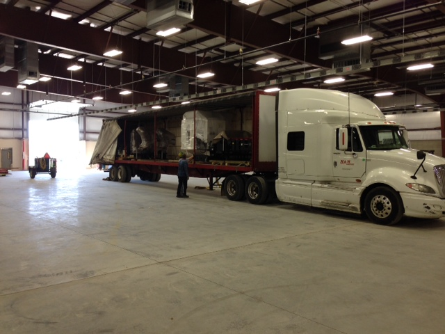 Equipment Being Unloaded And Staged